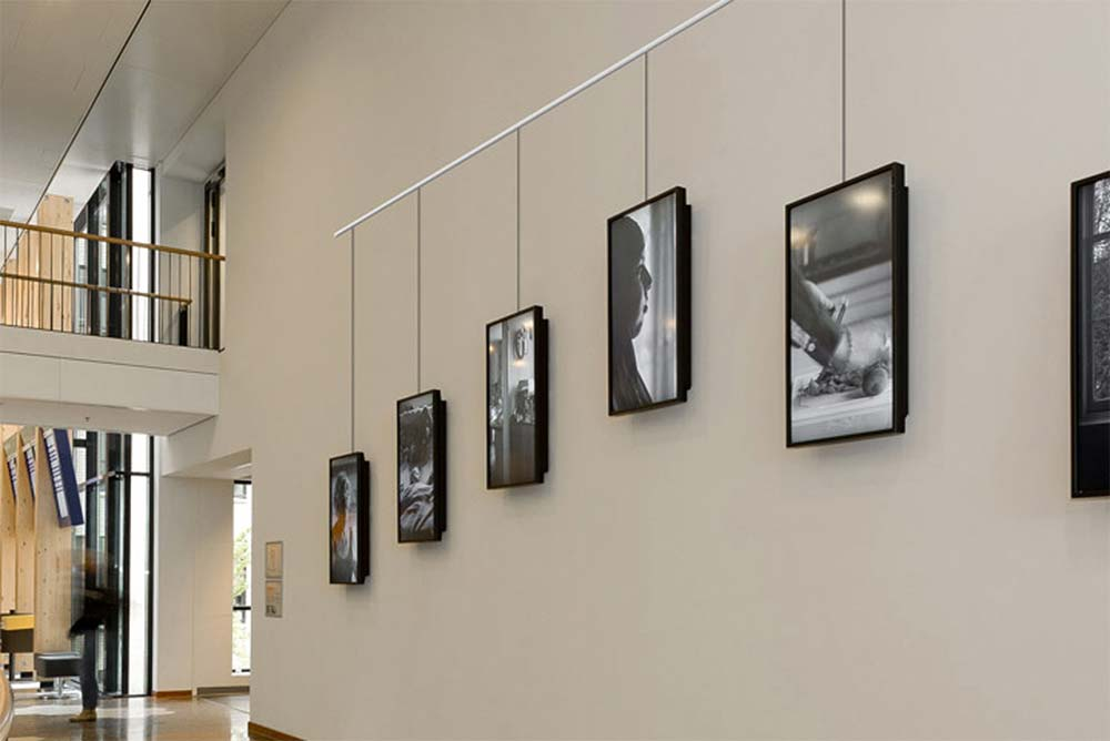 Pictures hung on the wall using the STAS picture hanging system