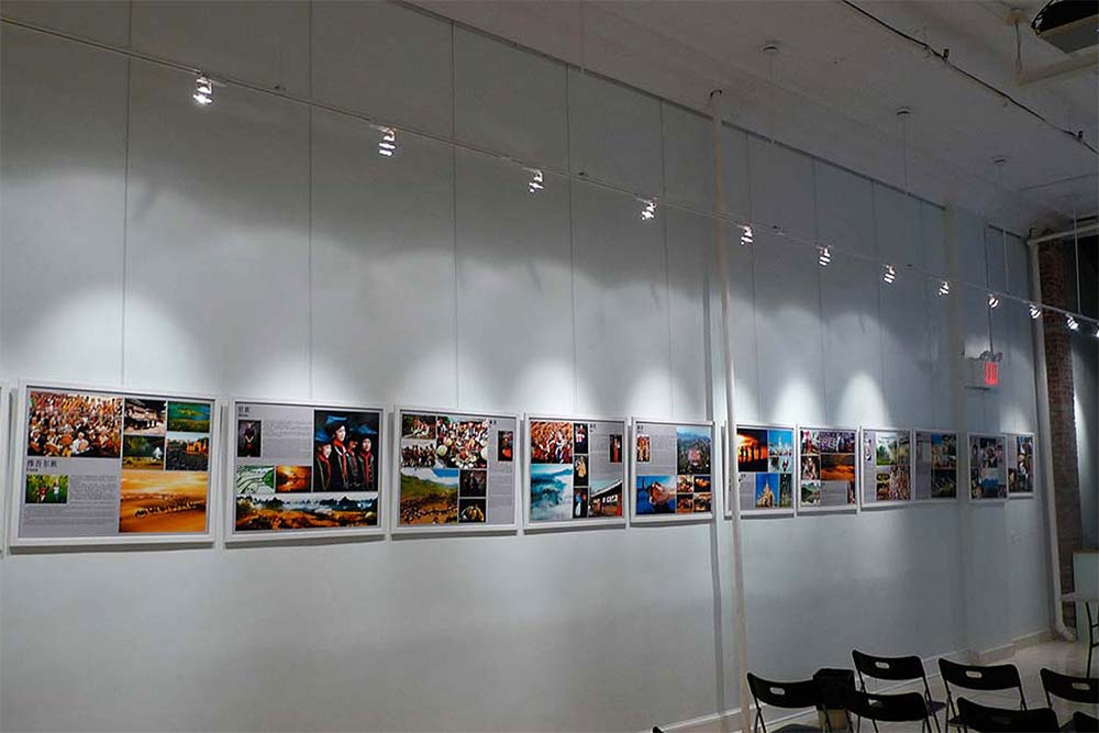 Various pictures on the wall with systematic art hanging system