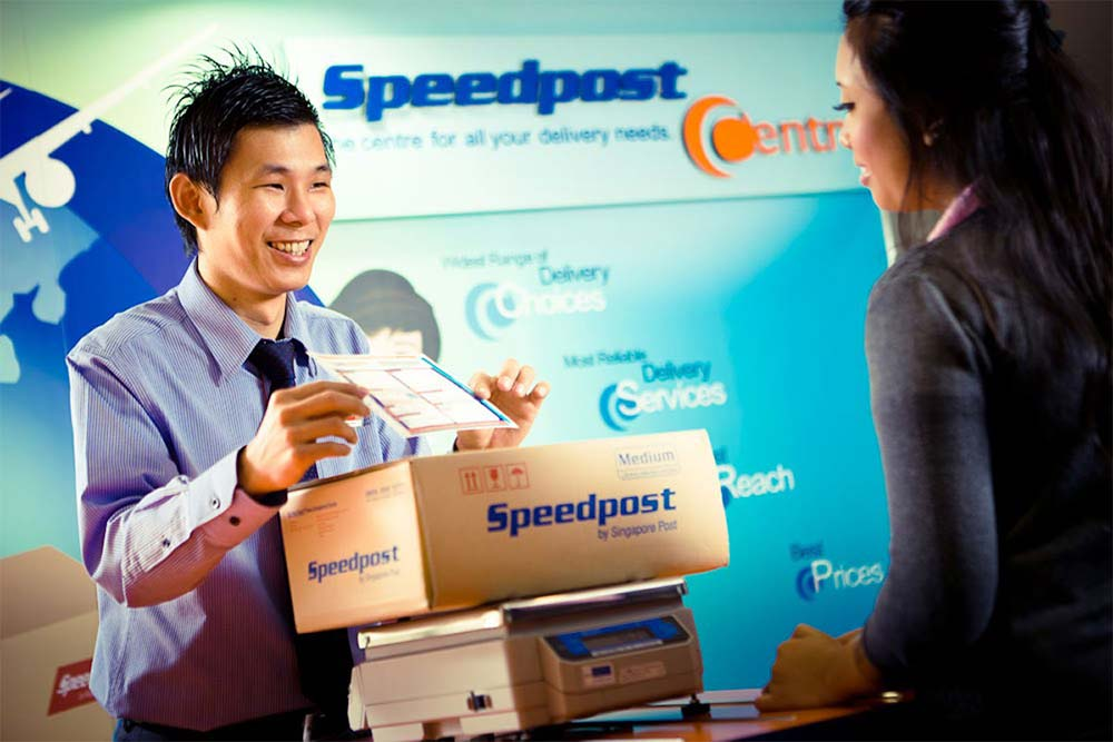 employee of speedpost singapore serving a customer